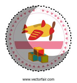 circular sticker with airplane and cubes toys