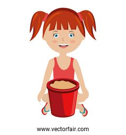 smiling girl with sand bucket toy