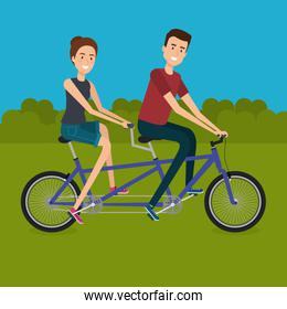 couple with bicycle in the landscape