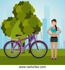 woman with bicycle in the landscape