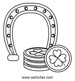 pile coins with clover and horseshoe