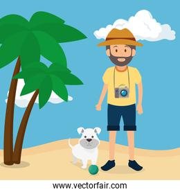 youn man with dog in the beach