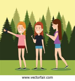 girls with smartphones in the camping zone