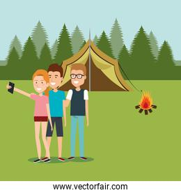 friends with smartphones in the camping zone