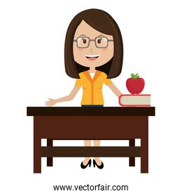 woman teacher in desk with apple and book