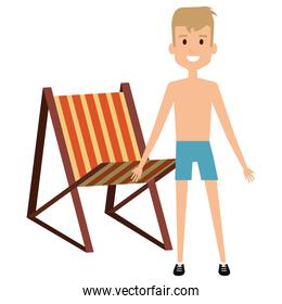 young boy with swimsuit and beach chair