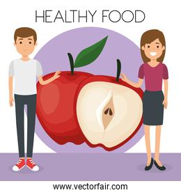 young couple with apples healthy food