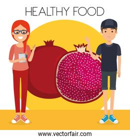 young couple with pomegranate healthy food