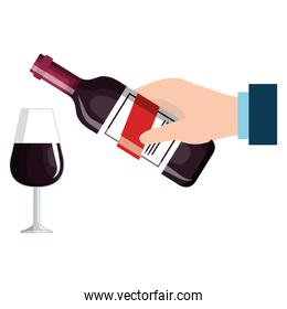 hand with wine bottle and cup