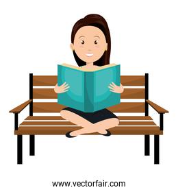 woman reading book in park chair