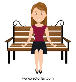 Woman sitting on park chair