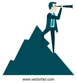 businessman with telescope in the mountain