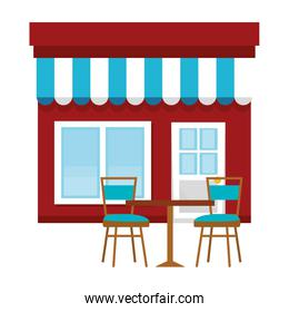 store building front with chairs and table