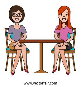 women seat in cafeteria table