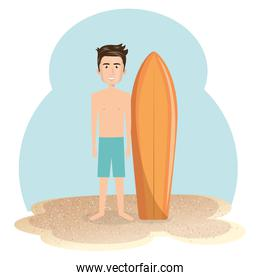 young man in the beach with surfboard