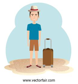 young man in the beach with suitcase
