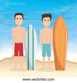 young men in the beach with surfboard