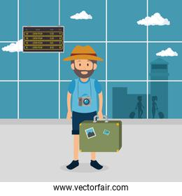 tourist man with suitcase in the airport