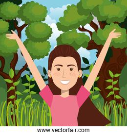 smiling woman celebrating in the jungle