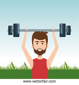 man weight lifting in the field
