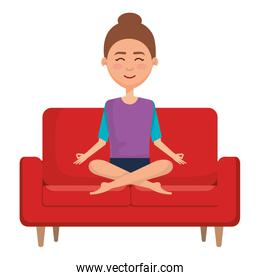 businesswoman doing the lotus position in the sofa