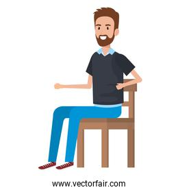 young man with beard sitting in wooden chair
