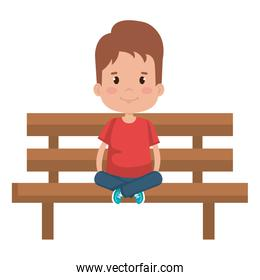 little boy sitting in park chair character