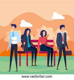 business people seated in the park chair