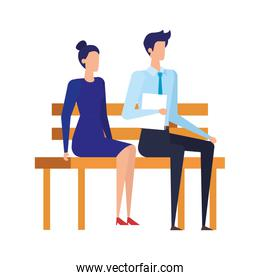elegant business couple seated in the park chair