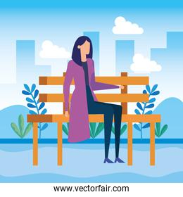 elegant businesswoman seated in the park chair