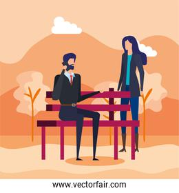 business couple calling with cellphone in the park chair