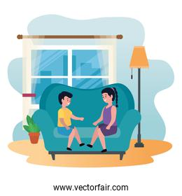 little kids couple seated in sofa
