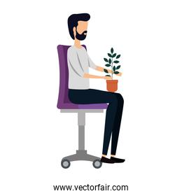 businessman with houseplant seated in office chair