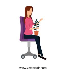 elegant businesswoman with houseplant seated in office chair