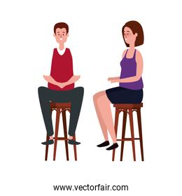elegant business couple seated in benchs