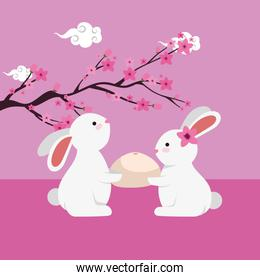 rabbits group witth tree branch floral scene