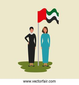 islamic women with traditional burka and arabia flag in pole