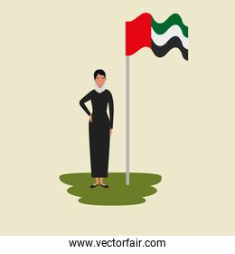 islamic woman with traditional burka and arabia flag in pole