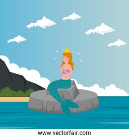 mermaid sitting in stone with sea