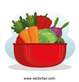 kitchen pot with fresh and organic vegetables