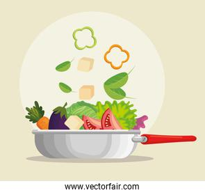 kitchen pan with fresh and organic vegetables