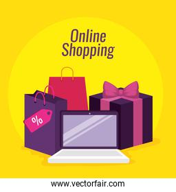 online shopping with laptop and packages with bags