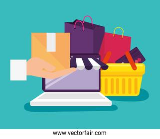 laptop technology to shopping online with basket and bags