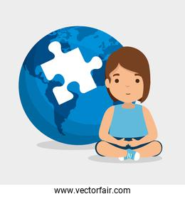 girl with puzzle inside global map to autism day