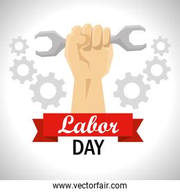 hand with wrench and gears to labor day