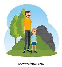 man fathers with his son and trees with bushes