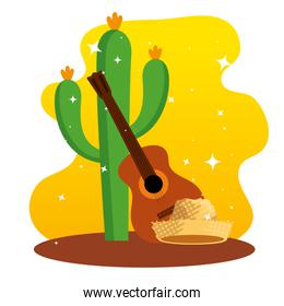cactus plants with guitar and hat decoration