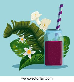 fresh beverage with exotic flowers and leaves