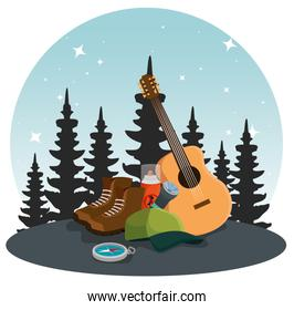 pines trees landscape with guitar and boots