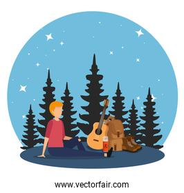 man with backpack and guitar with nature pines trees